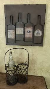 We have hundreds of fun decorations for your kitchen and home including wine bottle candelabras, wine cork cages, wine signs, and other hard to find wine decor. Metal Wine Wall Decor 15 1 2 X 15 1 2 And Wine Bottle Caddy With Glass Bottle Very Large Overland Park Estate Home Decor Sale Equip Bid
