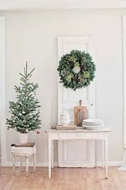 You can even use a small sized metal or aluminum container to house your  mini Christmas tree, especially if you want to recreate a shabby chic look.
