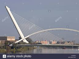 High Strung Overlapping Seville Bridges. Two modern bridges over the  Meandro San Jeronimo River join to make a sculptural form