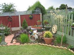 Small Picture Tropical Inexpensive Diy Rock Landscapes Red Fence Wall In Back