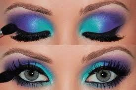 aqua and purple 80s style eye makeup with lots of black mascara totally rad
