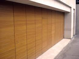 sliding garage doorsElegant Sliding Garage Doors in Natural Colour  Amaza Design
