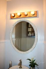 hollywood lighting fixtures. upgraded hollywood vanity light fixture strip with wood above oval mirror lighting fixtures