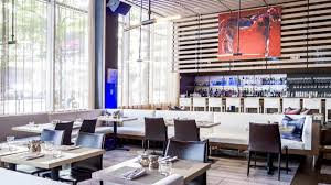 a painting by jörg madlener hangs above the bar at the gallery in the theater district
