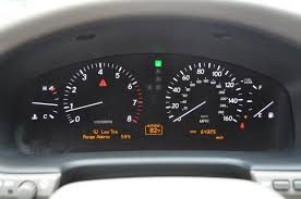 triangle light with low tire pressure 2006 lexus ls 430 jpg