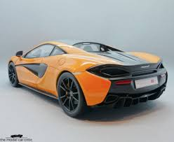 mclaren logo on car. the matching mclaren orange calipers with logo are done well plus discs themselves look fairly realistic mclaren on car