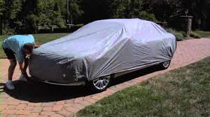 Image result for car covered with canvas
