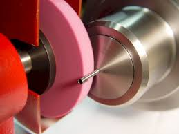 tool post grinder. removing a burr from an interchangeable counter-bore pilot. tool post grinder movie l