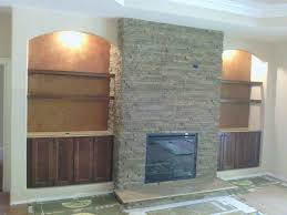 stone veneer fireplace and elephant hide accent build ins