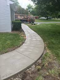 Another look at this curved sidewalk with a swirl finish .New Era Concrete  specializes in