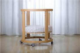 image of round bassinet and changing table combo