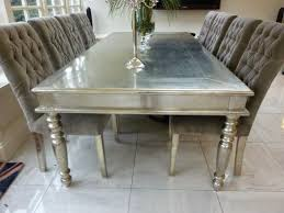 white metal dining table our white metal furniture is crafted in hardwood furniture is encased in a sheet of the white metal all done by hand too