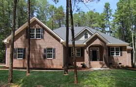 3 720 sq ft house plan 1 5 story home with four bedrooms 3 full bathrooms 2 half baths raleigh custom homes with a red brick exterior by stanton homes