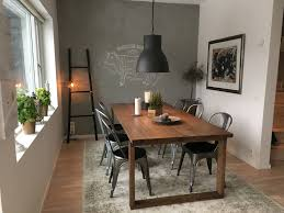essentials dining room design square table wooden seat carpet black chandelier window vases candle canvas painting