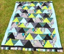 The Best Quilts to Make with Pre-Cut Fabric - Seams And Scissors & Cool and Quick Triangle Patterns Fat Quarter Quilt Patterns Adamdwight.com