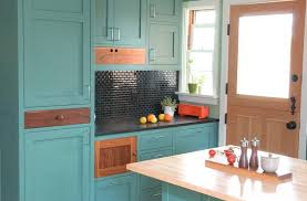 teal green painted kitchen cabinets