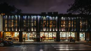 Green and Safe restaurant market faade at night