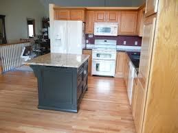 painted kitchen islandsAfter New island furnishing painted black to match new granite