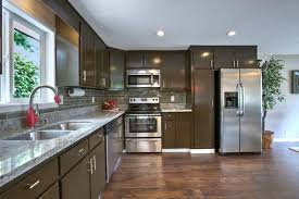 Traditional Kitchen with Hardwood floors & Complex granite ...