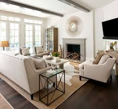 living room with sofa set and seagrass rug 8x10 also fireplace with sunburst wall mirror