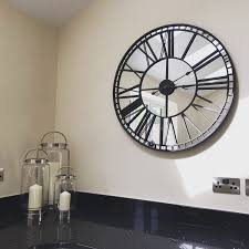 mirrored skeleton wall clock by libra