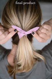leather strip and wrap them in opposite ways under the pony tail covering up the hair band then tie them in a double knot above the twist tie