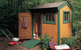 brown shed with green trim