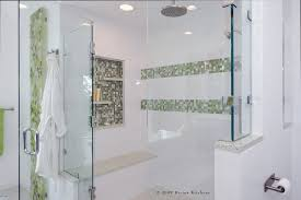 sumptuous frameless shower doors in bathroom contemporary with glass tile shower next to frameless glass tub enclosure alongside shower accent tile and