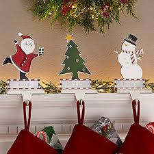 Buy personalized Christmas stocking holders for mantle engraved with any  names! Choose from 3 Christmas designs. Free personalization & fast  shipping.