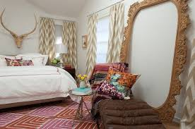 hand carved wooden frame adds visual height to the eclectic bedroom design angela