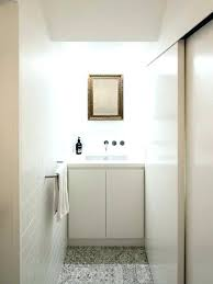 subway tile panel modern powder room in with flat cabinets white faux panels shower walls tiles