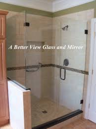 custom frameless glass shower door with notch glass panel with mitered corner and glass return panel
