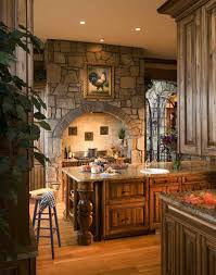 tuscan kitchen lighting. beautiful stonework and cabinetry in this kitchen kitchens kitchendesigns homechanneltv tuscan lighting e