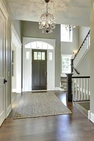 pottery barn sisal rug sisal rug pottery barn entry traditional with light green walls crystal chandeliers