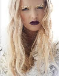 gold leaf eye makeup with dark lipstick