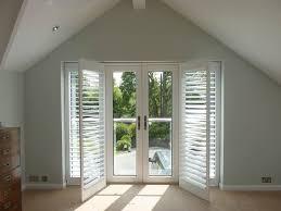 inward opening doors with shutters