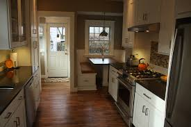 beautiful hardwood floors give this kitchen a rich warm feeling after replacing the door and windows the trim was reproduced in detail to match the rest