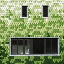 green shingles cover peculiar schuppen house by brandt simon architekten
