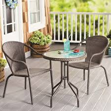 patio patio chairs patio furniture round table fence lemonade glass plate fruit