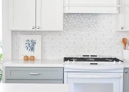 white iridescent hexagon tile kitchen backsplash
