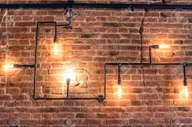 Image Restaurant Interior Design Of Vintage Wall Rustic Design Brick Wall With Light Bulbs And Pipes 123rfcom Interior Design Of Vintage Wall Rustic Design Brick Wall With