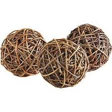 Rattan Decorative Balls Green decorative balls in a bowl add a lovely fresh touch to a 1