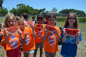 Phillippi Shores students cool off with field day - Lenia Unde, Collier  Moser, Irandy Ramos, Ghita DiNota and Ava Larson enjoy a slice of  watermelon at one of the Field Day stations.  