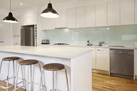 here s a fabulous way to highlight your kitchen s modern design by creating a reflective glass backsplash begin by painting the wall the color of your