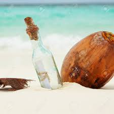 letter in a bottle a letter in a bottle and a coconut on the beach stock photo picture
