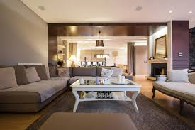 Light hardwood floors dark furniture Lighter Colored Deep Purples And Taupe Accents Give This Living Room Fresh And Contemporary Atmosphere The Home Stratosphere 22 Living Rooms With Light Wood Floors pictures