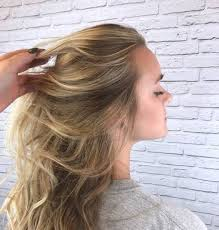 how to deal with frizzy hair redken