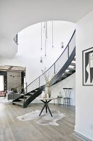 A dark wood floor and wood stair treads lead through and around the apartment, spiraling up onto the wood deck at the room. 50 Amazing And Modern Staircase Ideas And Designs Renoguide Australian Renovation Ideas And Inspiration