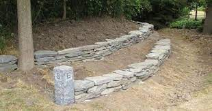 build a stacked stone garden wall
