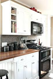 Black And White Cabinets Black Appliances And White Or Gray Cabinets